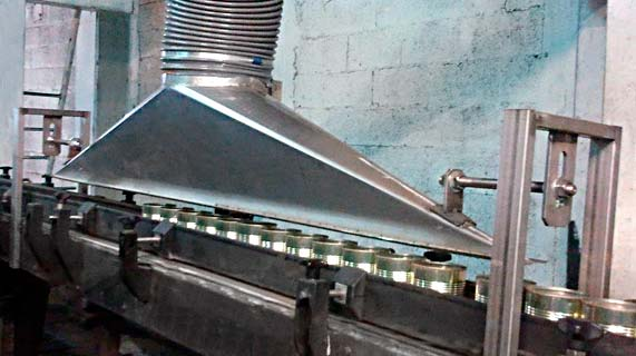 אידרן - הסרת טיפות מקופסאות שימורים במפעל